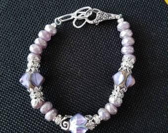 Purple wrist bauble bead bracelet with rhinestone sparkle