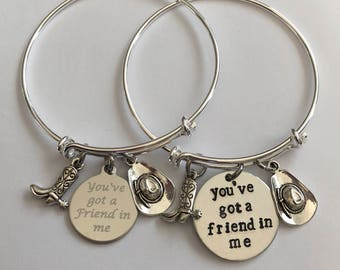 "Bracelet ""you've got a friend in me"" engraved charm with boot and cowboy hat stainless steel"