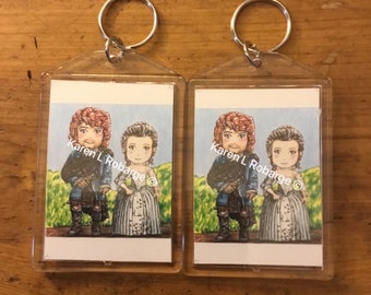 Jamie and Claire cartoon keychains.