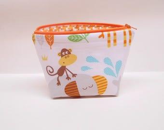 orange monkey makeup bag, monkey makeup pouch, elephant zipper pouch, elephant zipper bag, monkey on elephant, cheeky monkey zipper bag