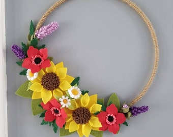 Spring had sprung! Beautiful felt floral wreaths made especially for you. Please let me know if you'd like specific colors and flowers.