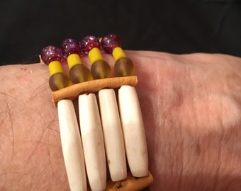 Native American tribal bracelet made of hair pipe, clay, and glass beads.