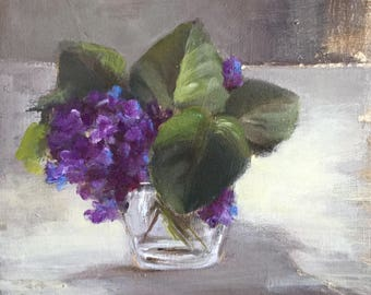Bouquet of violets in a glass