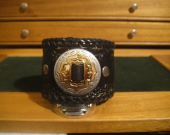 Large double loop two-toned slotted concho cuff