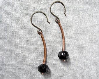 Black Moon Harvest earrings - brass finished metal round hooks with antiqued copper curved tubes & etched jet black glass bead earrings