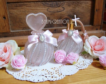 Pair of vintage Pink Perfume bottles