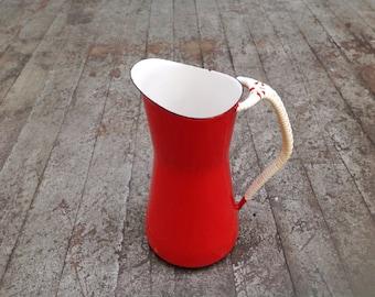 Red enamelware Dansk Kobenstyle pitcher . By Jens Quistgaard . 1950s mid century modern