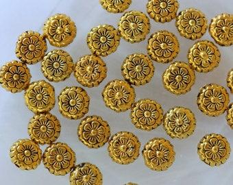 set of 4 gold metal flower disc beads