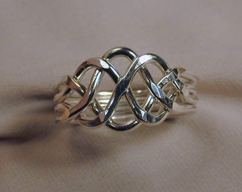 4pc. puzzle ring Sterling Silver