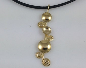 Gold pendant necklace, Spiral pendant, Leather necklace cord, Gold necklace, Gold spirals, Gold and black