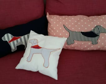 Cushions filled with Doggie-shaped applications