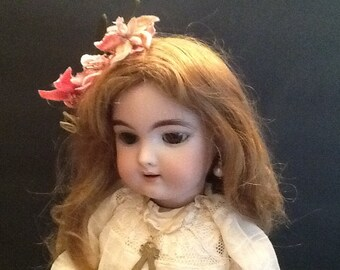 Antique German bisque doll. Heinrich Handwerck.
