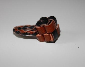 """Kera braided leather ring"