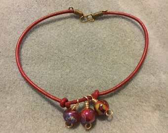 Red Ankle Bracelet With Beaded Dangles On Leather Cord