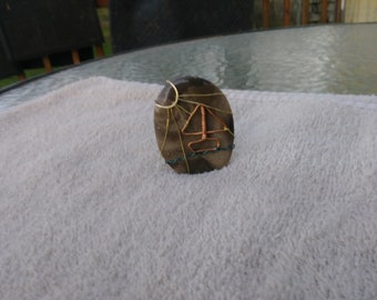 Charlevoix Stone with wire wrapped boat scene