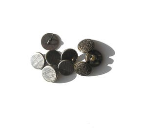 9 silver metal buttons 6 buttons striated and 3 buttons with filigree pattern.
