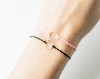 Set of 2 cord bracelets with geometric karma circle