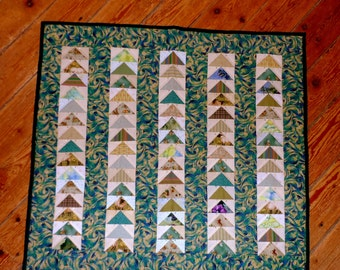 Flying Geese over the Lagoon : 100% hand sewn cotton quilt.