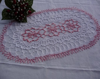 Oval napkin is hand crocheted cotton white and pink shades.