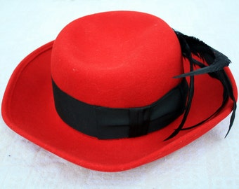 Vintage Red Felt Hat by Commodore with Black Ribbon, Black Feather and Golden Vintage Pin
