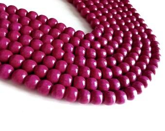 Perles rondes en bois naturel teint rose framboise 12x11mm - 30 unités