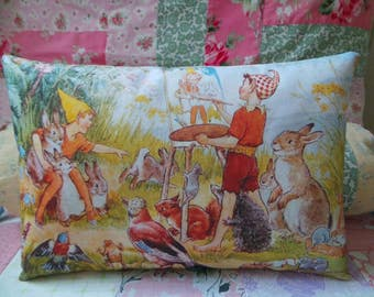 Margaret Tarrant illustration of elves painting which has been hand printed onto fabric to make into a cushion, vintage, story book, pixies