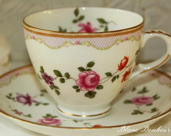 Crown Staffordshire, England: Charming tea cup and saucer with flowers