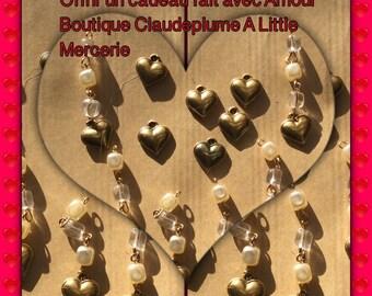 Set of 12 hearts pendants