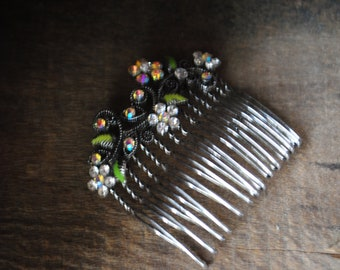Art nouveau vintage 70s, silver tone metal hair comb with a a delicate multicolor rhinstones  flowers and green enamel leaves between.