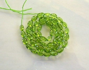 "Peridot faceted oval beads AA+ 7-9.5mm 15"" strand"