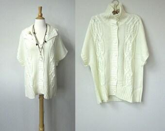 Hiver neuf ancien Stock manches courtes laine crème Cardigan pull tunique avec point de câble en tricot et le bouton à l'avant fermeture, coupe ample