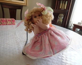 "Very Cute 14"" Porcelain Curly Blond Baby Doll in Pink, Blue Tu Tu and Orange Wings"