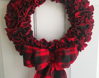 Red and black plaid ribbon wreath.