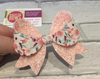 large franchi glitter flora hair bow.