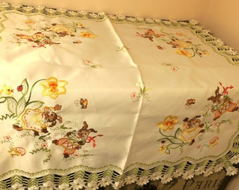 "Satin Tablecloth w Embroidered Bunnies,Daisies, Butterflies, Birds, Drums, Ribbons, Flowers and more. 32 x 32"" Like new NOS"
