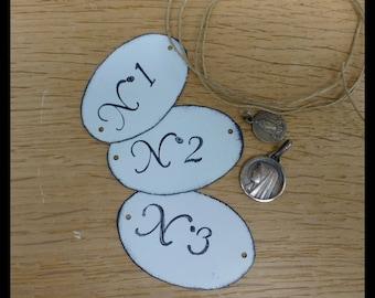Oval metal number tags