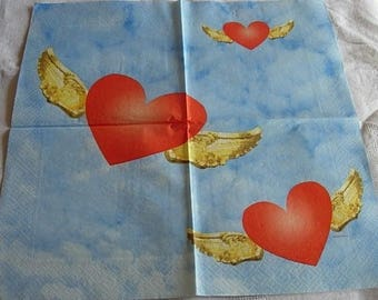 Red hearts on blue paper towel