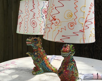 Elmer and Lucinda Velociraptor-Steinmetz wish to light up your life!