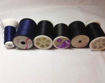 Six Large Spools of Black and Navy Blue Thread Including All Purpose Polyester Thread and Upholstery Thread