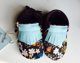 Genuine brown leather moccasins with floral fabric overlay and blue or Salmon upper fringe
