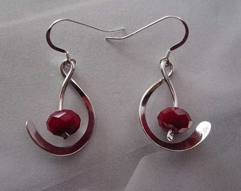 Two Pairs of Ruby Quartz Served on Sterling Silver