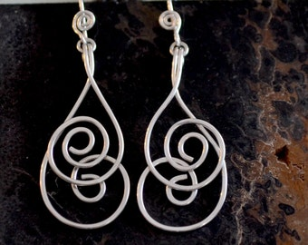 "Sterling silver spiral earrings. Silver dangle earrings.  hand forged.  ""whirlwind"""