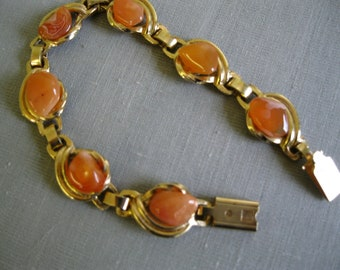 Vintage Jewelry Gold toned linked bracelet with orange stones unsigned 7 inch