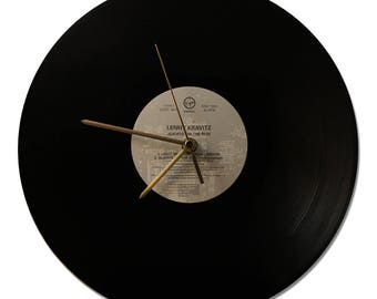 "CLOCK VINYL LENNY KRAVITZ ""ALWAYS ON THE RUN"" 33 tours"