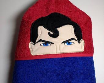 Hooded towel with Superman peeker.