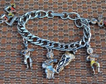 Vintage Mid Century Calypso Steel Band Charm Bracelet - Silvertone