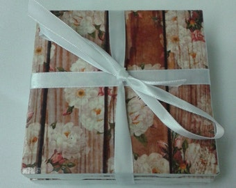 White flowers and pink buds on rustic wood panel-look coasters. Set of 4 decoupage tile coasters.