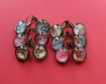 6 pairs of earrings with various glass cabochons