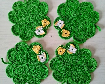 Four-leaf clover coasters with butterflies