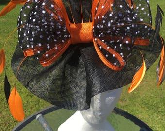Bespoke Black and orange sinamay and polka dot bow with feathers